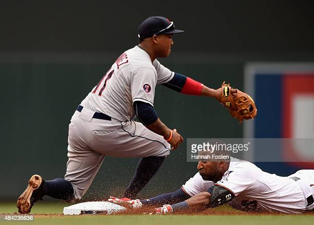Eduardo Nunez of the Minnesota Twins slides into second base safely with a double against Jose Ramirez of the Cleveland Indians during the second...