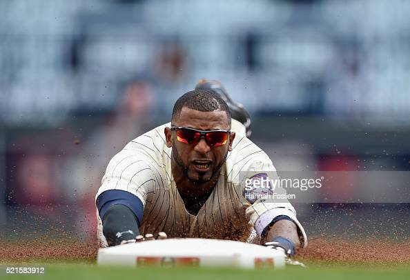 Eduardo Nunez of the Minnesota Twins slides into third base safely after hitting a triple against the Los Angeles Angels of Anaheim during the first...