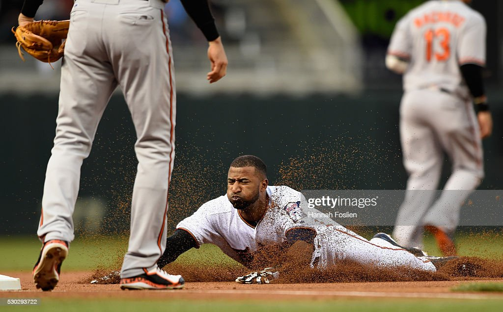 <a gi-track='captionPersonalityLinkClicked' href=/galleries/search?phrase=Eduardo+Nunez&family=editorial&specificpeople=4900197 ng-click='$event.stopPropagation()'>Eduardo Nunez</a> #9 of the Minnesota Twins slides safely into third base against Ryan Flaherty #3 of the Baltimore Orioles during the first inning of the game on May 10, 2016 at Target Field in Minneapolis, Minnesota.