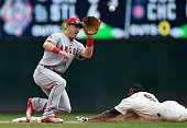 Eduardo Nunez of the Minnesota Twins steals second base as Cliff Pennington of the Los Angeles Angels of Anaheim fields the ball during the second...