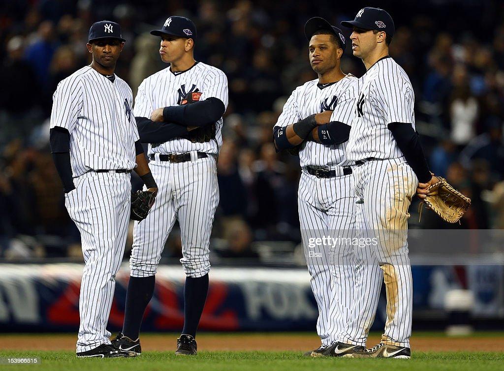 Eduardo Nunez #26 of the New York Yankees, Alex Rodriguez #13, Robinson Cano #24, and Mark Teixeira #25 look on during a pitching change in Game Four of the American League Division Series against the Baltimore Orioles at Yankee Stadium on October 11, 2012 in the Bronx borough of New York City.
