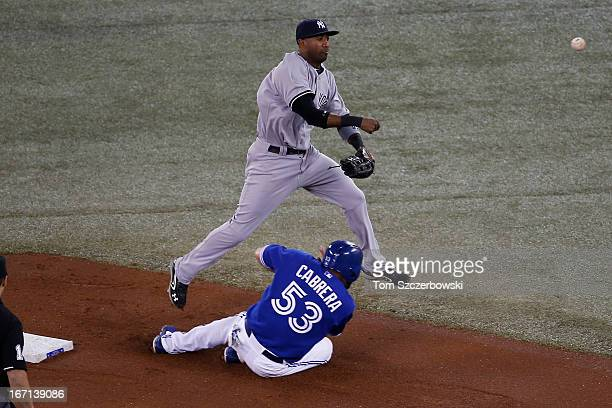 Eduardo Nunez of the New York Yankees commits a throwing error in the first inning after forcing out Melky Cabrera of the Toronto Blue Jays at second...