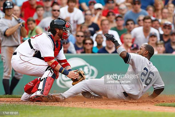 Eduardo Nunez of the New York Yankees is tagged out at home plate by Jarrod Saltalamacchia of the Boston Red Sox in the fifth inning during the game...
