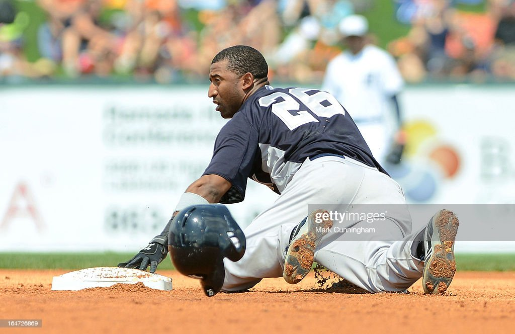 Eduardo Nunez #26 of the New York Yankees slides into second base during the spring training game against the Detroit Tigers at Joker Marchant Stadium on March 23, 2013 in Lakeland, Florida. The Tigers defeated the Yankees 10-6.