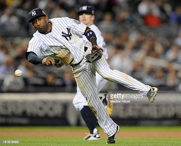 Eduardo Nunez of the New York Yankees throws to first to force out Delmon Young of the Tampa Bay Rays during the fifth inning on September 25 2013 at...