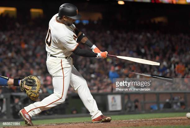 Eduardo Nunez of the San Francisco Giants breaks his bat hitting an rbi single to score Buster Posey against the Los Angeles Dodgers in the bottom of...