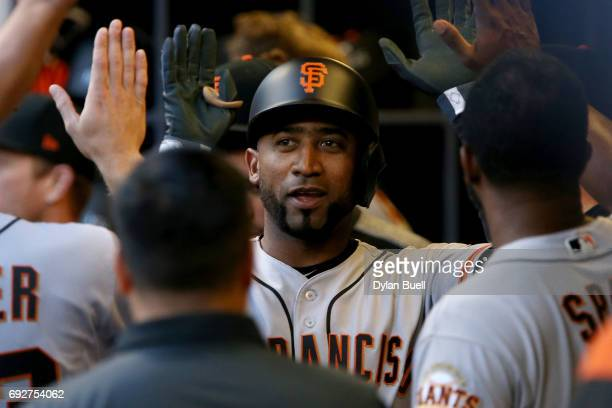 Eduardo Nunez of the San Francisco Giants celebrates with teammates after hitting a home run in the fifth inning against the Milwaukee Brewers at...