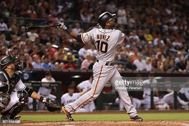 Eduardo Nunez of the San Francisco Giants hits a sacrifice fly against the Arizona Diamondbacks during the second inning of the MLB game at Chase...