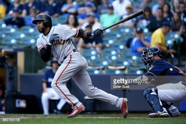 Eduardo Nunez of the San Francisco Giants hits a single in the first inning against the Milwaukee Brewers at Miller Park on June 5 2017 in Milwaukee...