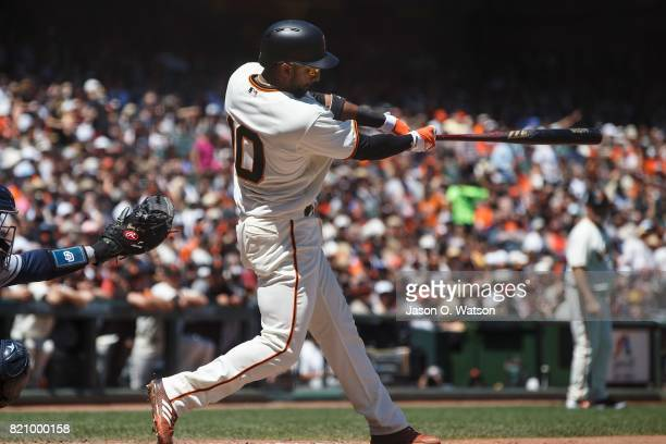 Eduardo Nunez of the San Francisco Giants hits a two run single against the San Diego Padres during the fourth inning at ATT Park on July 22 2017 in...