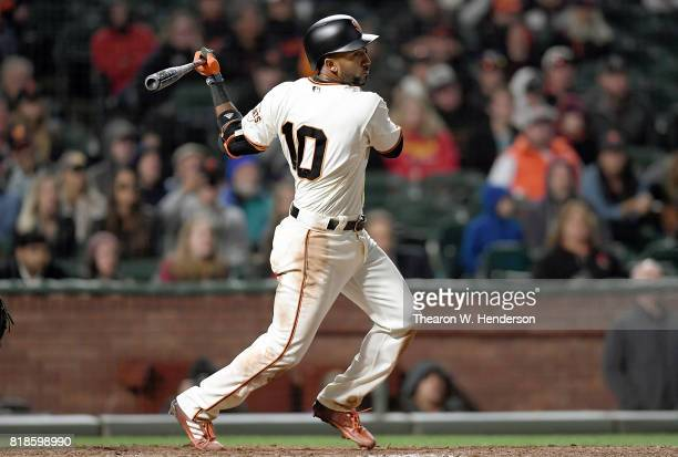 Eduardo Nunez of the San Francisco Giants hits a walkoff RBI single scoring Kelby Tomlinson against the Cleveland Indians in the bottom of the 10th...