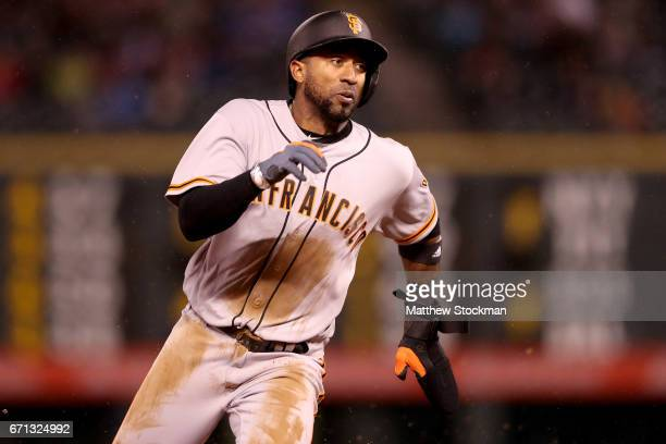 Eduardo Nunez of the San Francisco Giants rounds third base to score on a RBI single hit by Joe Panik in the eighth inning against the Colorado...