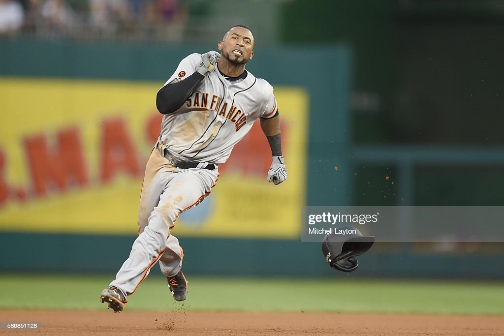 Eduardo Nunez #10 of the San Francisco Giants runs to third for a triple in the forth inning during a baseball game against the Washington Nationals at Nationals Park at on August 6, 2016 in Washington, DC.