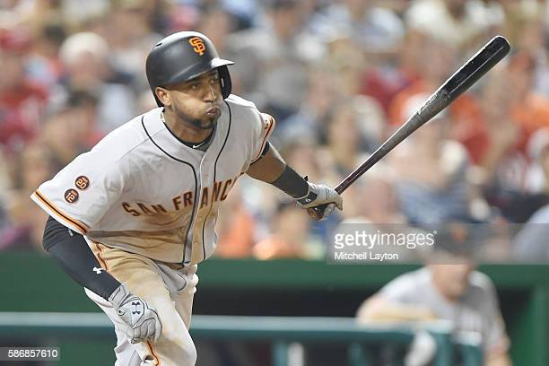 Eduardo Nunez of the San Francisco Giants singles in the seventh inning during a baseball game against the Washington Nationals at Nationals Park at...