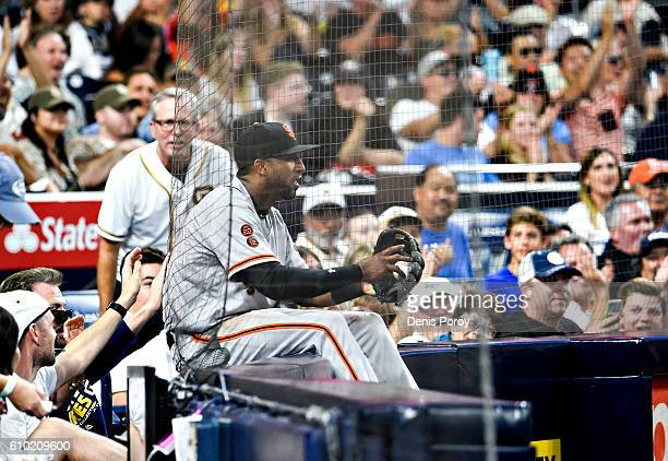 Eduardo Nunez of the San Francisco Giants sits against the backstop netting after making the catch on a foul ball hit by Carlos Asuaje of the San...