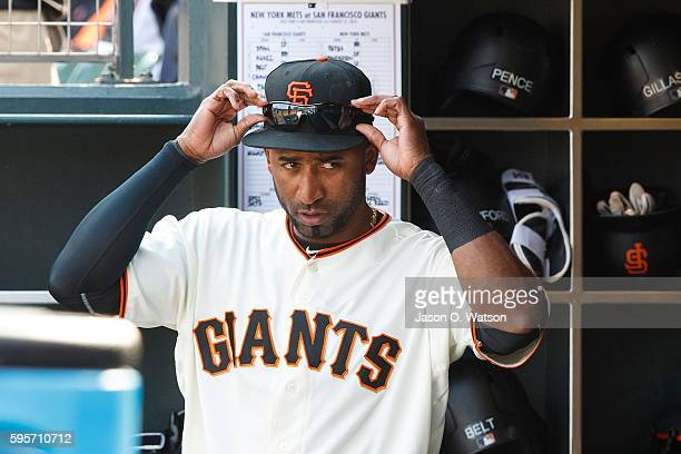 Eduardo Nunez of the San Francisco Giants stands in the dugout before the game against the New York Mets at ATT Park on August 21 2016 in San...