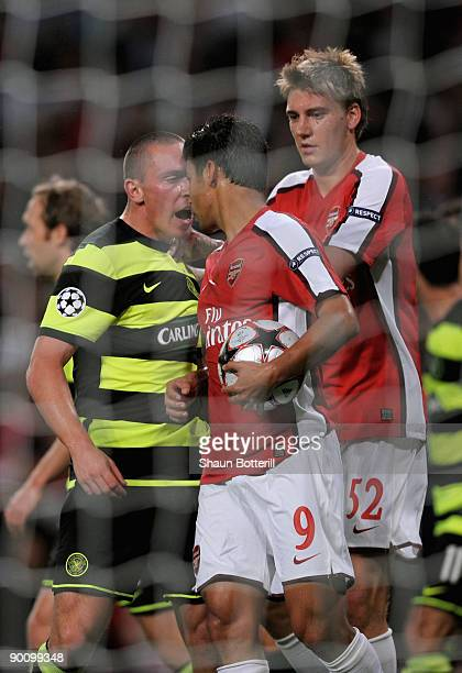 Eduardo of Arsenal is confronted by Scott Brown of Celtic after winning a first half penalty for his team during the UEFA Champions League 2nd...