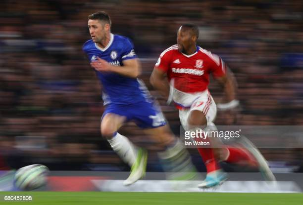 Eduardo of Chelsea chases Gary Cahill of Chelsea during the Premier League match between Chelsea and Middlesbrough at Stamford Bridge on May 8 2017...