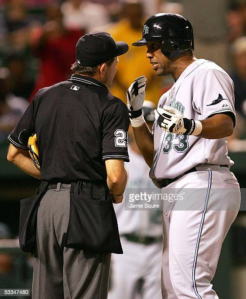 Eduardo Perez of the Tampa Bay Devil Rays argues with home plate umpire Bill Hohn during the 9th inning of the game against the Baltimore Orioles on...