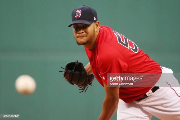 Eduardo Rodriguez of the Boston Red Sox delivers in the first inning of a game against the Seattle Mariners at Fenway Park on May 26 2017 in Boston...