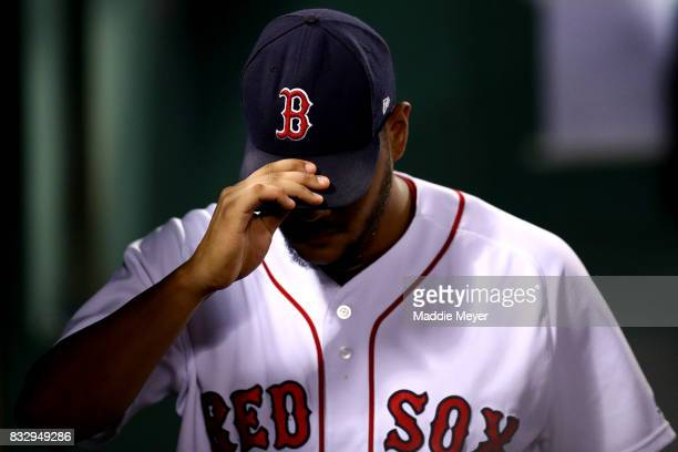 Eduardo Rodriguez of the Boston Red Sox in the dugout during the third inning against the St Louis Cardinals at Fenway Park on August 16 2017 in...