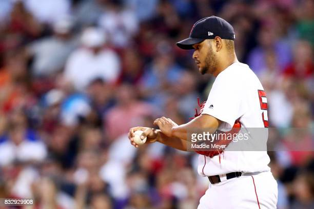 Eduardo Rodriguez of the Boston Red Sox reacts after allowing four runs during the second inning against the St Louis Cardinals at Fenway Park on...