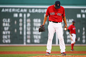 Eduardo Rodriguez of the Boston Red Sox reacts after Brian Dozier of the Minnesota Twins hit a home run during the second inning at Fenway Park on...