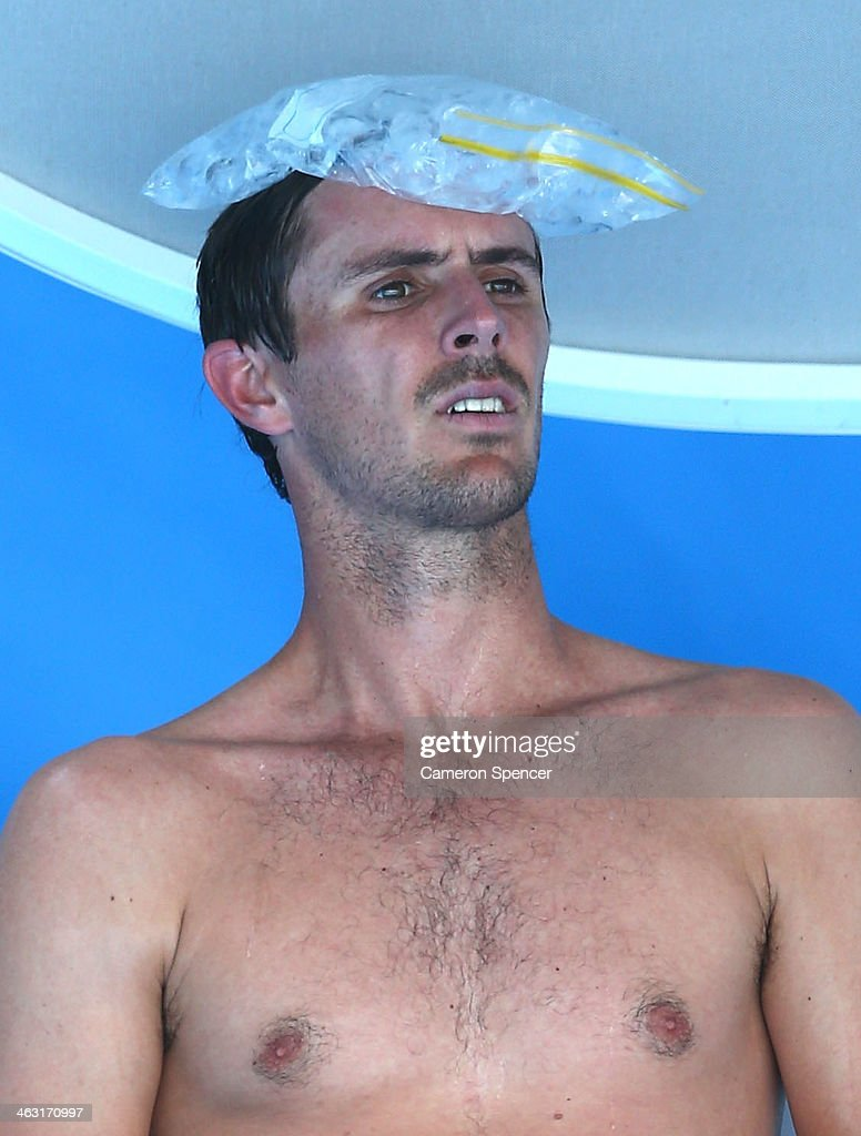 Eduardo Roger-Vasselin of France cools off in his third round singles match against Kevin Anderson of South Africa during day five of the 2014 Australian Open at Melbourne Park on January 17, 2014 in Melbourne, Australia.