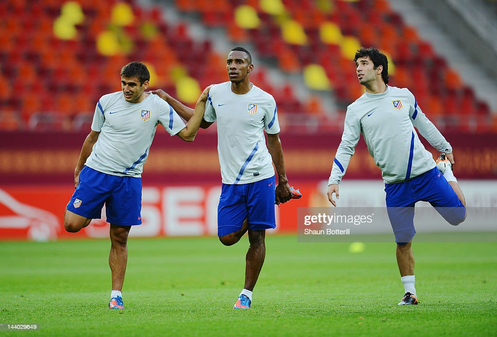 Eduardo Salvio, Luis Perea and Arda Turan of Atletico Madrid warm up during the Atletico Madrid training session ahead of the UEFA Europa League Final between Atletico Madrid and Athletic Bilbao at the National Arena on May 8, 2012 in Bucharest, Romania.