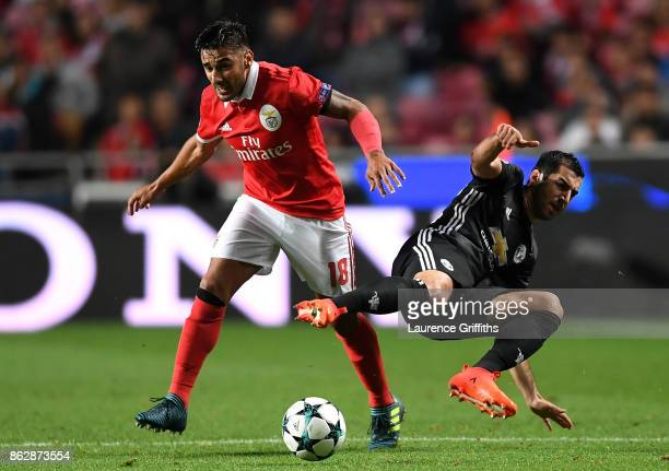 Eduardo Salvio of Benfica and Henrikh Mkhitaryan of Manchester United battle for possession during the UEFA Champions League group A match between SL...