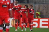 Eduardo Salvio of Benfica celebrates his team's first goal with team mates Nicolas Gaitan and Luisao during the UEFA Europa League match round of 32...