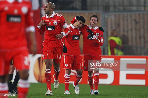 Eduardo Salvio of Benfica celebrates his team's first goal with team mates Nicolas Gaitan and Luisao during the UEFA Europa League match round of 32...