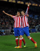 Eduardo Salvio of Club Atletico de Madrid celebrates scoring his sides opening goal with his teammate Adrian Lopez during the UEFA Europa League...