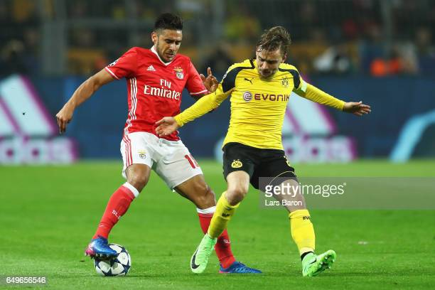 Eduardo Salvio of SL Benfica battles for the ball with Marcel Schmelzer of Borussia Dortmund during the UEFA Europa League Round of 16 first leg...