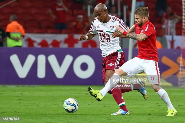 Eduardo Sasha of Internacional battles for the ball against Marlon Santos of Fluminense during the match between Internacional and Fluminense as part...