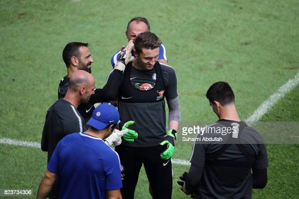 Eduardo shares a light moment with Marcin Bulka during an International Champions Cup Chelsea FC training session at Singapore American School on...