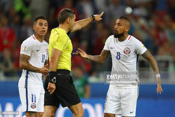 Eduardo Vargas of Chile and Arturo Vidal of Chile appeal to referee Damir Skomina after Chile had a goal disallowed during the FIFA Confederations...