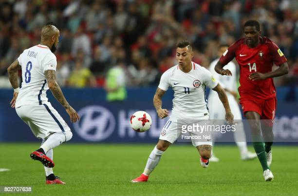 Eduardo Vargas of Chile and William Carvalho of Portugal battle for possession during the FIFA Confederations Cup Russia 2017 SemiFinal between...