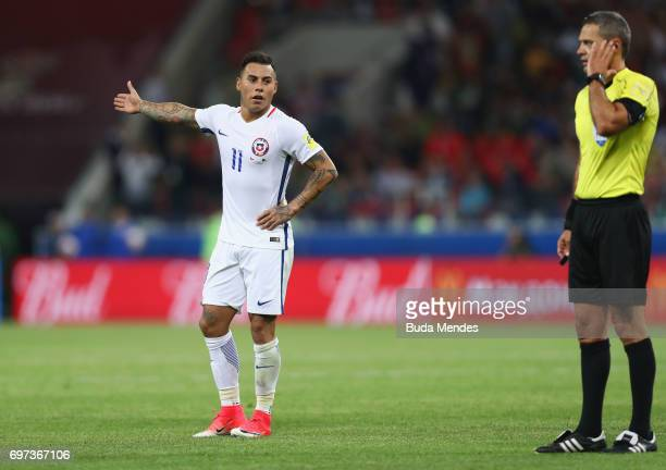 Eduardo Vargas of Chile appeals as referee Damir Skomina listens to his ear piece during the FIFA Confederations Cup Russia 2017 Group B match...