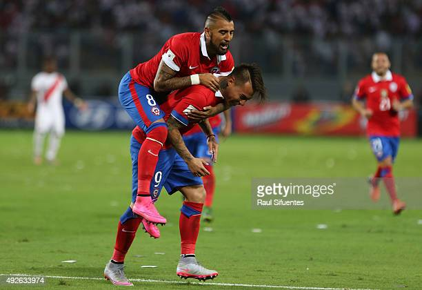 Eduardo Vargas of Chile celebrates with Arturo Vidal after scoring the fourth goal during a match between Peru and Chile as part of FIFA 2018 World...
