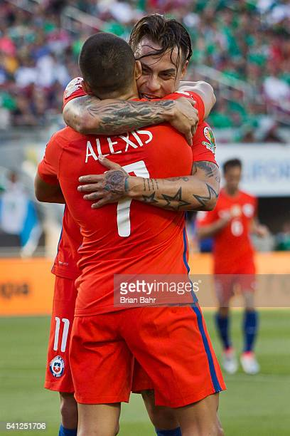 Eduardo Vargas of Chile celebrates with teammate Alexis Sanchez after scoring during a Quarterfinal match between Mexico and Chile at Levi's Stadium...