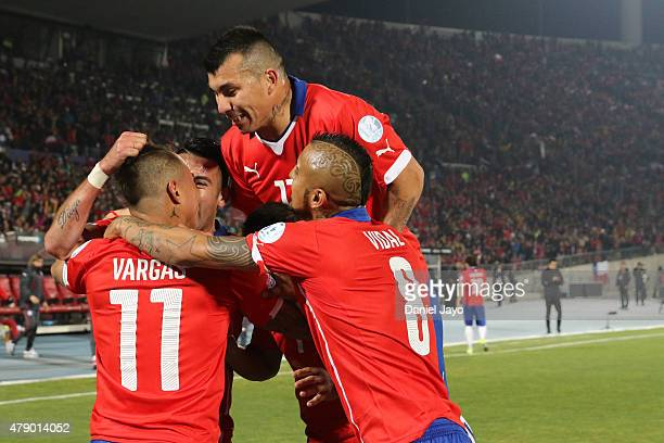 Eduardo Vargas of Chile celebrates with teammates after scoring the second goal of his team during the 2015 Copa America Chile Semi Final match...