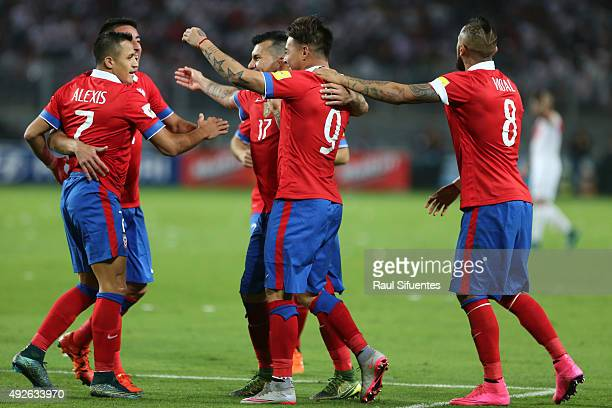 Eduardo Vargas of Chile celebrates with teammates after scoring the fourth goal of his team against Peru during a match between Peru and Chile as...