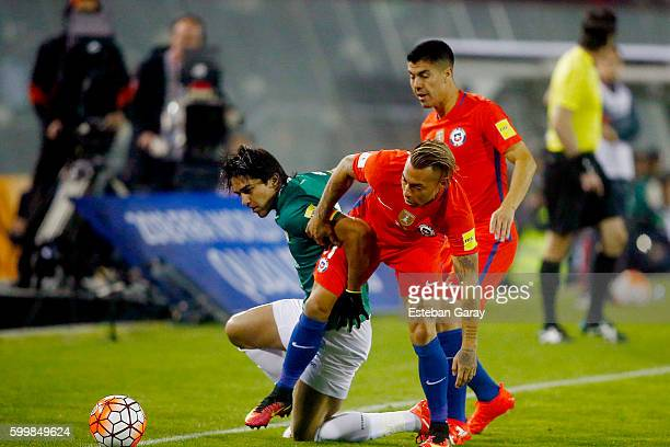 Eduardo Vargas of Chile fights for the ball with Marcelo Martins of Bolivia during a match between Chile and Bolivia as part of FIFA 2018 World Cup...