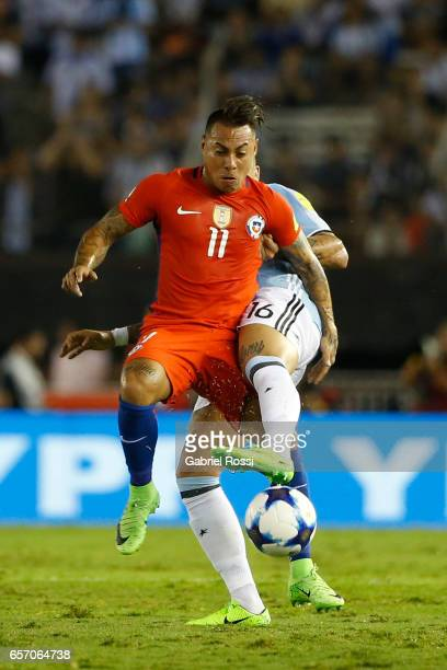 Eduardo Vargas of Chile fights for the ball with Marcos Rojo of Argentina during a match between Argentina and Chile as part of FIFA 2018 World Cup...