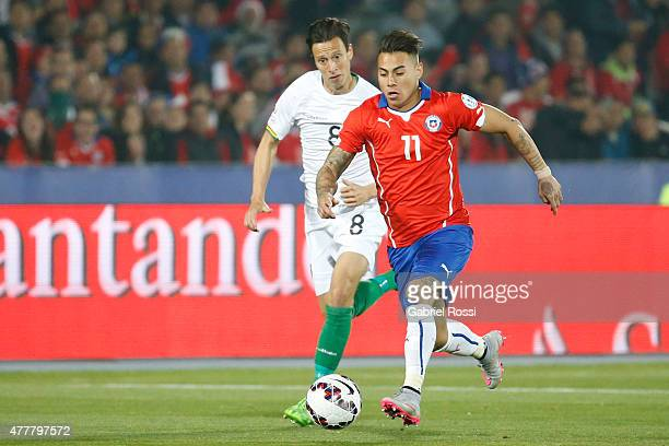 Eduardo Vargas of Chile fights for the ball with Martin SmedbergDalance of Bolivia during the 2015 Copa America Chile Group A match between Chile and...