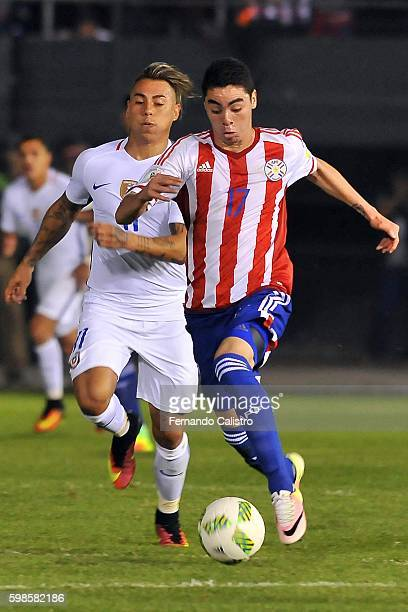 Eduardo Vargas of Chile fights for the ball with Miguel Almiron of Paraguay during a match between Paraguay and Chile as part of FIFA 2018 World Cup...