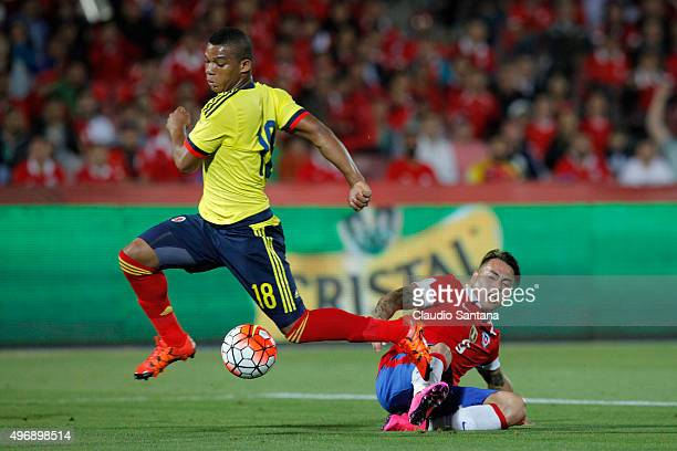 Eduardo Vargas of Chile fights the ball with Frank Fabra of Colombia during a match between Chile and Colombia as part of FIFA 2018 World Cup...