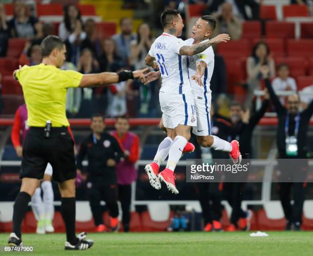 Eduardo Vargas of Chile national team celebrates with Leonardo Valencia of Chile national team as referee Damir Skomina allows his goal after...