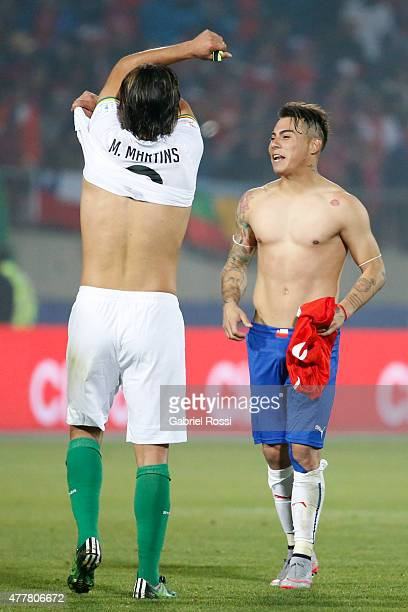 Eduardo Vargas of Chile swaps his jersery with Marcelo Moreno Martins of Bolivia during the 2015 Copa America Chile Group A match between Chile and...
